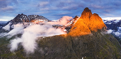 Aerial view of Romsdalshornet and Venjetinden mountain lit by sunset, Romsdalen valley, Andalsnes, More og Romsdal, Norway, Scandinavia, Europe