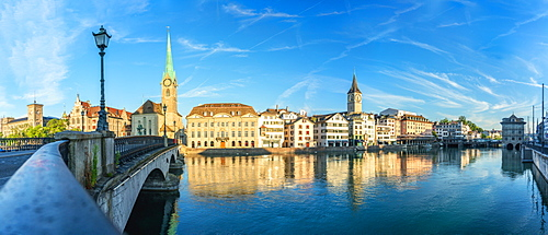 Panoramic of Fraumunster church and Limmat River seen from Munsterbrucke bridge at sunrise, Zurich, Switzerland, Europe