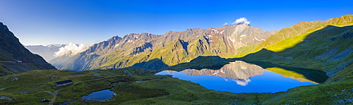 Aerial panoramic of Cima di Pietrarossa mirrored in Lago Nero at dawn, Gavia Pass, Valfurva, Valtellina, Lombardy, Italy, Europe