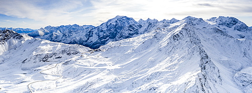 Aerial view by drone of Stelvio Pass road and snowy Ortles mountain, Sondrio province, Valtellina, Lombardy, Italy, Europe