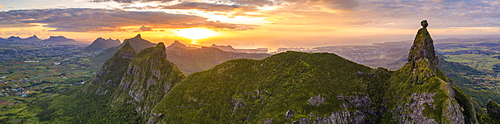 Aerial panoramic of sunset over Le Pouce and Pieter Both mountains, Moka Range, Port Louis, Mauritius, Africa