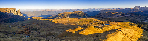 Aerial view by drone of autumn sunrise over Alpe di Siusi (Seiser Alm), Dolomites, South Tyrol, Italy, Europe