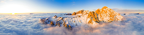 Panoramic aerial view of Grigne group mountain peaks emerging from mist at sunset, Lake Como, Lecco province, Lombardy, Italy, Europe