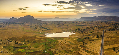 Aerial panoramic by drone of asphalt road crossing the inland area towards Gheralta Mountains, Dugem, Tigray Region, Ethiopia, Africa