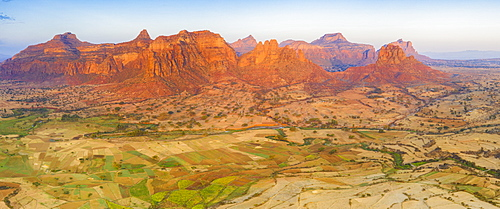 Cultivated fields at feet of the majestic Gheralta Mountains, aerial view by drone, Megab, Tigray Region, Ethiopia, Africa