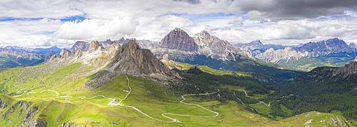 Aerial panoramic of Giau Pass, Ra Gusela, Nuvolau, Averau and Tofane mountains in summer, Dolomites, Veneto, Italy, Europe