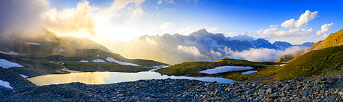 Sunrise over Mittleres Schwarziseeli lake and Galenstock mountain peak in background, Furka Pass, Canton Uri, Switzerland, Europe