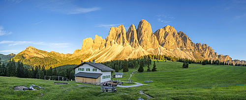 Sunset over Sass Rigais, Furchetta and Odle peaks seen from Glatsch Alm hut, Val di Funes, South Tyrol, Dolomites, Italy