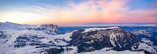 Sunrise over Sciliar Massif and Compatsch village covered with snow, aerial view, Seiser Alm, Dolomites, South Tyrol, Italy, Europe