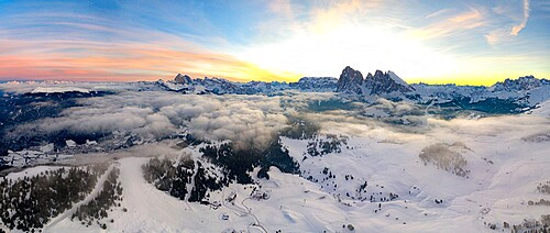 Aerial view of the snowcapped Sassolungo and Sassopiatto mountains at dawn, Seiser Alm, Dolomites, South Tyrol, Italy, Europe