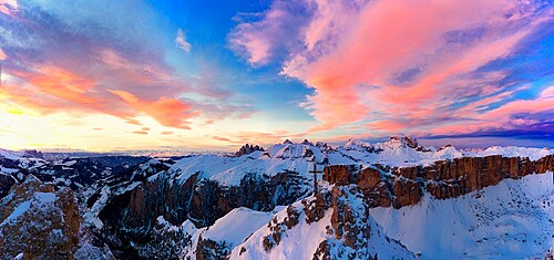Pink clouds in the sky at sunset over Gran Cir and Odle mountains covered with snow in winter, Dolomites, South Tyrol, Italy, Europe
