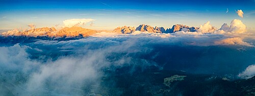 Aerial panoramic view of Brenta Dolomites emerging from clouds, Madonna di Campiglio, Trento, Trentino-Alto Adige, Italy, Europe