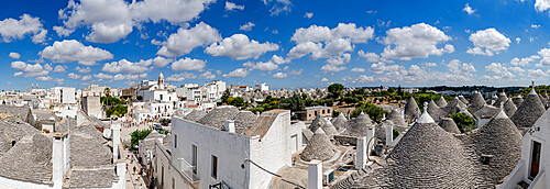 Trulli traditional stone huts and Itria Valley in summer, Alberobello, province of Bari, Apulia, Italy