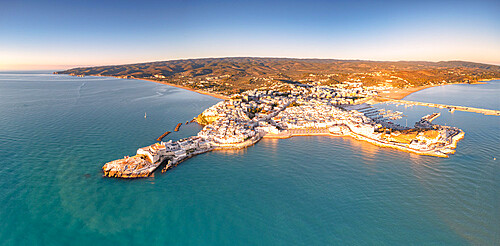 Aerial view of Vieste at sunrise in summer, Foggia province, Gargano National Park, Apulia, Italy
