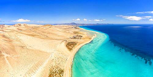Sand beach of Costa Calma washed by turquoise sea, aerial view, Jandia Nature Park, Fuerteventura, Canary Islands, Spain