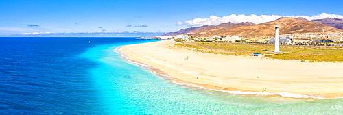 Aerial view of the white sand beach and lighthouse of Morro Jable, Fuerteventura, Canary Islands, Spain