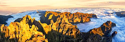 Aerial panoramic of Pico das Torres and Pico do Arieiro mountains in a sea of clouds at sunset, Madeira, Portugal, Atlantic, Europe