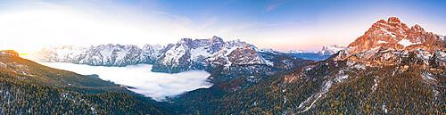 Sunrise over lake Misurina covered by clouds, Monte Cristallo, Sorapis and Marmarole group, Dolomites, Veneto, Italy