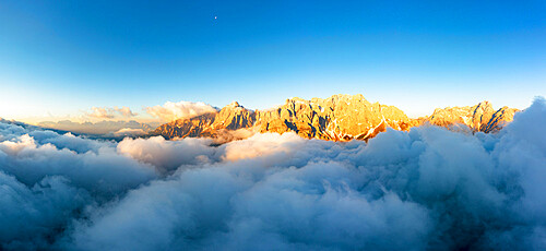 Aerial view of Popera group, Cima Undici and Croda Rossa di Sesto rock peaks emerging from clouds, Dolomites, South Tyrol, Italy, Europe