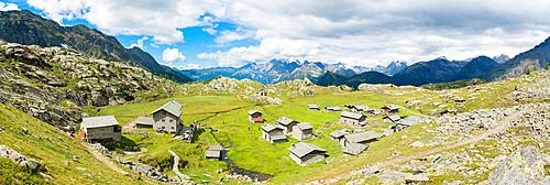 Stone huts and Rifugio Cristina surrounded by Rhaetian Alps, Alpe Prabello, Valmalenco, Valtellina, Lombardy, Italy, Europe