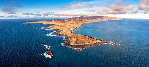 Aerial panoramic of Punta Jandia lighthouse (Faro de la Lola) and Atlantic Ocean at sunset, Fuerteventura, Canary Islands, Spain, Atlantic, Europe
