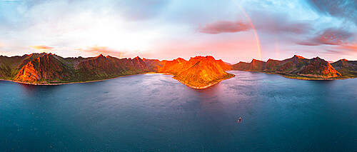 Aerial view of arctic sea with Ersfjord and Steinfjord fjords under the rainbow at midnight sun, Senja, Troms county, Norway