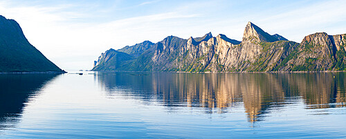 Majestic mountains Segla and Hesten along the unspoiled waters of Mefjord, Senja, Troms county, Norway