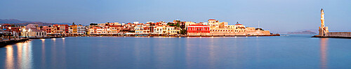 Panoramic of the old Venetian port and lighthouse during the blue hour, Chania, Crete, Greece