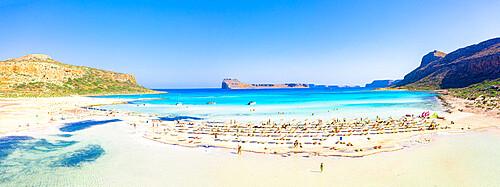 People sunbathing on idyllic white sand beach, Balos, Crete, Greece