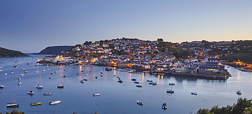 An atmospheric dusk view across the Salcombe village and estuary, on the south coast of Devon, England, United Kingdom, Europe