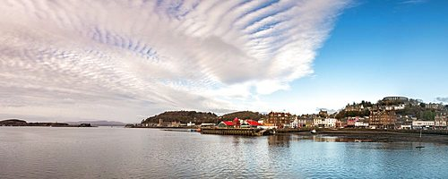 Panorama of Oban, Highlands, Scotland. Looking out into Oban Bay and the Sound of Mull beyond.