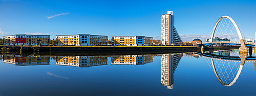 Panoramic reflection of Clyde Arc (Squinty Bridge) and flats, River Clyde, Glasgow, Scotland, United Kingdom, Europe