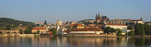 Panorama of Prague Castle, Hradcany, Mala Strana, and Charles Bridge lit by sunrise, UNESCO World Heritage Site, Prague, Czech Republic, Europe