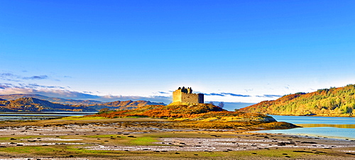 Castle Tioram on the coastal island Eilean Tioram where River Shiel and Loch Moidart meet, at low tide on a sunny winter morning, Highlands, Scotland, United Kingdom, Europe - 1246-11