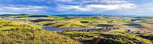 Panorama of Chinteni village and lake in summer, Romania, Europe
