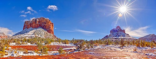 Panorama of Courthouse Butte and Bell Rock with a coating of winter snow on their slopes in Sedona, Arizona, United States of America, North America