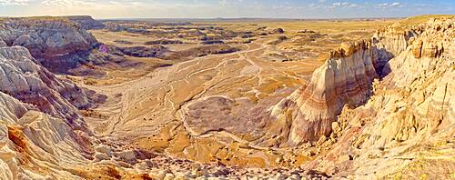 A sheer cliff of rock jutting out from the Blue Mesa along the Billings Gap Trail in Petrified Forest National Park Arizona.