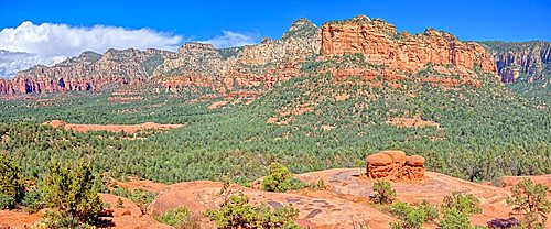 Panorama of Chicken Rock on the right and Submarine Rock on the left with Munds Mountain in the background. Located in Sedona.