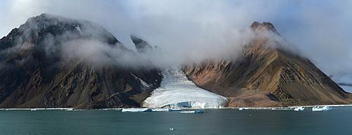 Panorama image of glacier fingers coming down to seashore, Nunavut and Northwest Territories, Canada, North America