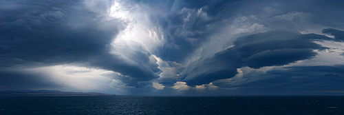 Panorama image of Lenticular clouds over the ocean, Nunavut and Northwest Territories, Canada, North America