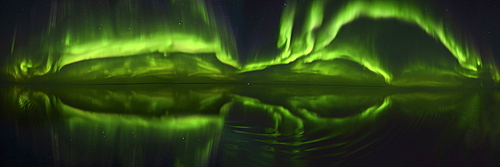180 degree panorama of the Northen Lights (Aurora Borealis) over the ocean, Nunavut and Northwest Territories, Canada, North America