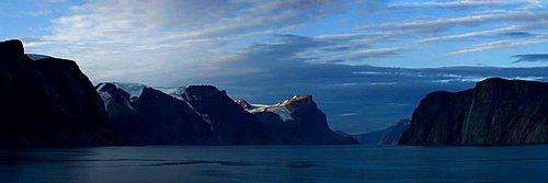 Glacier carved mountain range. Entrance to Sam Ford Fjord