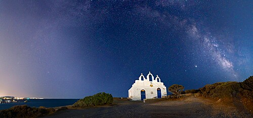Milky Way arches above Agios Georgios on Paros Island, Cyclades, Greek Islands, Greece, Europe