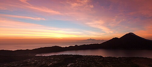 Pink panoramic sunrise from the top of Batur volcano, Bali, Indonesia, Southeast Asia, Asia