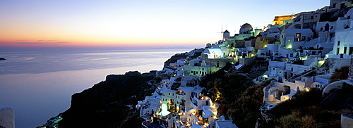 View over the town of Oia at twilight with Aegean Sea in the background, Santorini (Thira), Cyclades Islands, Greek Islands, Greece, Europe