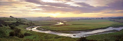 Meandering River Aln at sunset, Foxton, near Alnmouth, Northumberland, England, UK