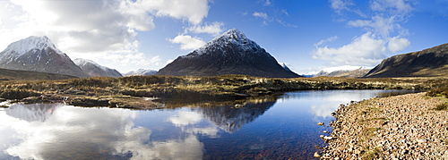 Panoramic view across River Etive towards snow-covered mountains including Buachaille Etive Mor, Rannoch Moor, near Fort William, Highland, Scotland, United Kingdom, Europe