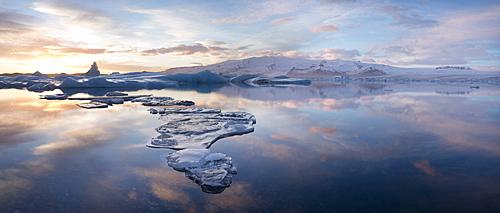 Panoramic view at sunset during winter over Jokulsarlon, a glacial lagoon at the head of the Breidamerkurjokull Glacier on the edge of the Vatnajokull National Park, South Iceland, Iceland, Polar Regions