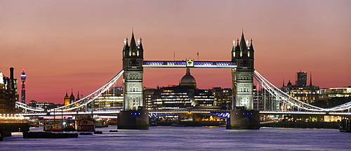 Panoramic view of Tower Bridge framing St. Paul's Cathedral at dusk, London, England, United Kingdom, Europe