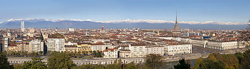 Panoramic cityscape shows Mole Antonelliana and Alps, Turin, Piedmont, Italy, Europe